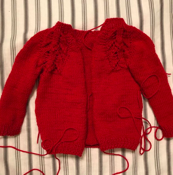 Work in Progress WIP liliana Sweater by Anne Dresow. Hand knit baby sweater, heirloom knits, red alpaca yarn.